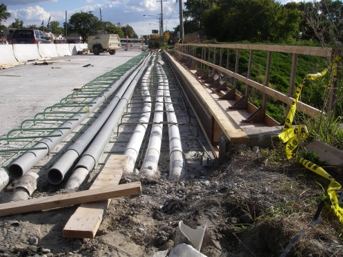 PVC tubes under sidewalk rebar